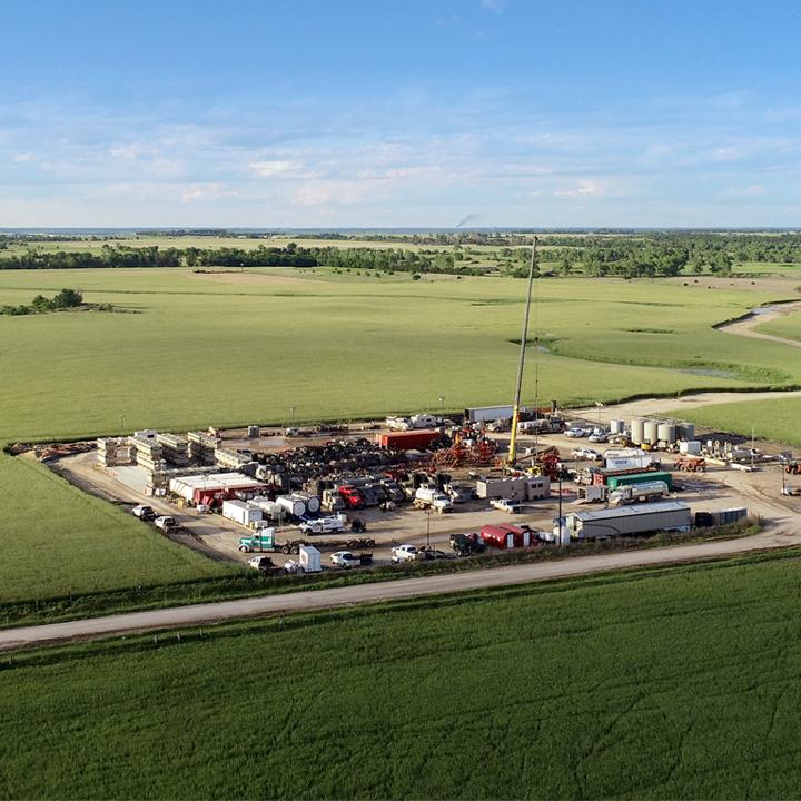 Ovintiv (previous;y Encana Corporation) Anadarko oil rig in a green field