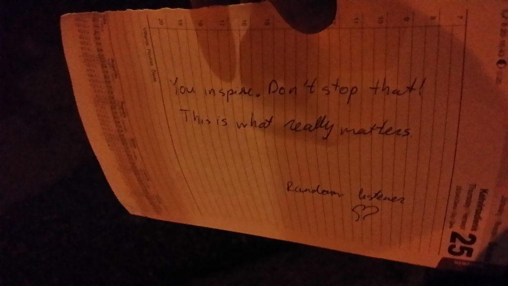Text on a paper in the dark reads: you inspire. don't stop that. This is what really matters. Random listener. Heart sign.